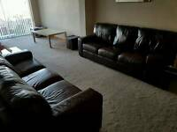 Two 3 seater Leather Sofas Dark Chocolate brown purchased from Housing Units