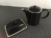 Black coffee pot and butter dish.