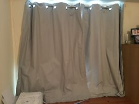 Blackout curtains and expandable rail