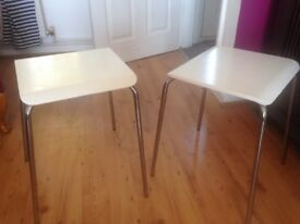 Two white Ikea Gilbert stools