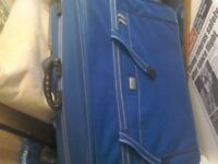 A big and handeynsuit case in blue it has weels and handle