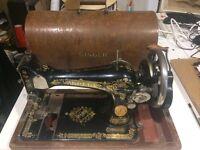 Vintage antique hand crank Singer sewing machine