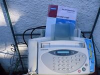 Samsung Fax Machine// Hitachi Video Player plus seperate house phone.