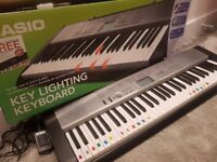 Bargain!! Full sized casio keyboard lk 120 with illuminated keys