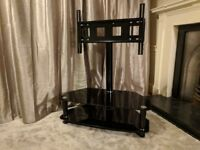 Black glass TV stand with integrated mount