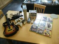 Xbox 360 bundle with Kinect, 3 controllers, hard drive, remote control and 18 games