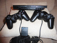 Sony PS2...(Slim Version) Two controllers, 8GB Memory card.