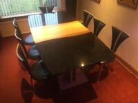 Marble topped dining table and seven chairs