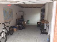 Large, clean and secure garage with light and power for rent
