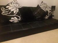 Black faux leather double sofa bed