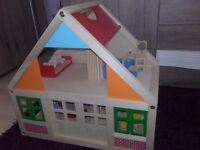Brand new wooden dolls house with some wooden dolls and many furnitures