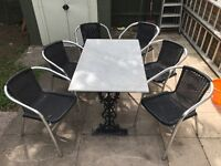 Marble table ( steel frame) with x6 aluminium threaded chairs