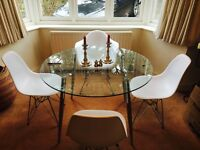 Glass dining table seats 4