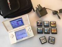 Nintendo DS Lite + Case + 8 Massive Games - Mario Kart - Sims 2 Pets - Super Mario Bros & More