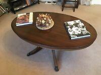 mahogany coffee table claw feet lounge magazine books centre piece