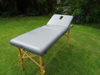 Sturdy massage table in new condition.