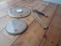 drum skins, drum sticks and brushes