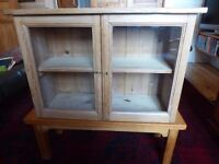 Small pine cuboard with glass doors and one shelf