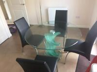 Spiral dining table and 4 black matching chairs