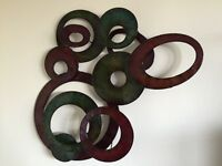 Eye-catching green and purple metal wall sculpture