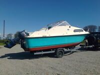 Shetland 19 Foot Cabin Boat with a 70HP PTT Auto Lube Outboard on a 29 Roller self centering Trailer