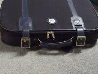 Carlton International blue suitcase