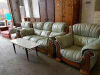 Large light green leather three seater and 2 armchairs suite