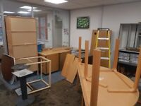 Office tables and cabinets and swivel chairs