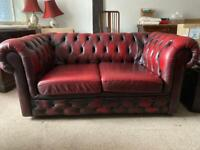 Two x 2 seater red leather Chesterfield sofas and 1 armchair