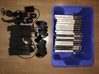 PlayStation 2, 17 games, 2 SingStar mics, 2 controllers and memory card all in good condition