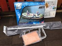 """Inflatable dinghy ( voyager 500 ) , two adults + two children max. capacity , size 142"""" x 65"""""""