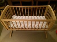 Mothercare Swinging Crib in natural wood.