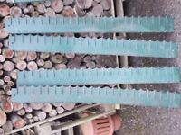 PLASTIC LAWN EDGING STRIPS. SIX AT FOUR FEET AND FIVE HALVES. PICK UP MATLOCK OR NOTTINGHAM