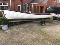 "17ft 6"" fibreglass lake lough fishing boat with galvanised trailer and spare wheel."