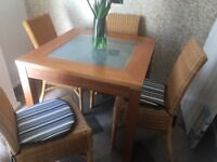 TABLE AND 4 WICKER CHAIRS