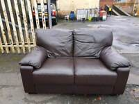 Brown leather 2 seater sofa in new condition