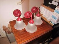 Three red glass wall lamps in good condition