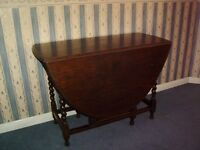 ANTIQUE LARGE DROP LEAF TABLE AND FOUR CHAIRS