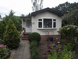 Loveley Mobile Home in Woodland Surroundings