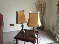 Two table lamps. Bronze base and gold shades. Excellent condition