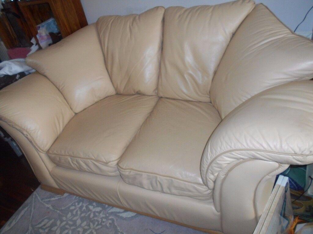 Cream Leather 2 seater sofa.