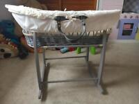 Grey wicker Moses basket