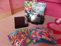 Wii u console + handheld controller+5 games