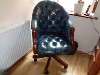 Blue leather swivel tub chair on castors