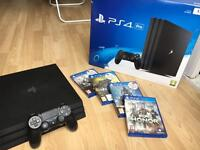 PS4 PRO (Playstation 4 Pro) with ACTIVE WARRANTY & GAMES (few months old)