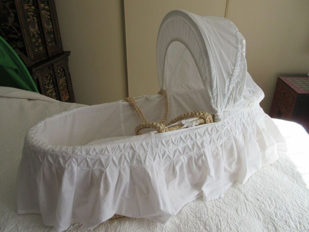 Mothercare Moses Basket complete with canopy and dressing.