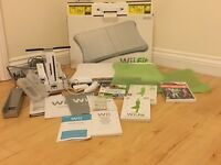 Nintendo Wii (with Wii Fit board, controllers, charging station and games)