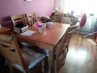 Big table with extended middle and 6 chairs