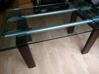 heavy glass top dining room table and 5 black leather chairs