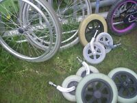 Job lot of wheelchair wheels all with shaft and locking nut many uses